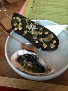 """A """"vegetal oyster"""" which was in fact cucumber and mint gel with squid ink tapioca, and a mashed potato squid ink crisp covered in blobs of fish mousse. Shouldn't work. Totally does."""